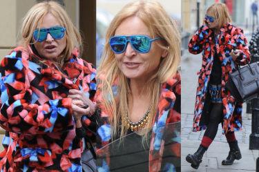 Olejnik w niebieskich okularach i kolorowym płaszczu... (ZDJĘCIA)